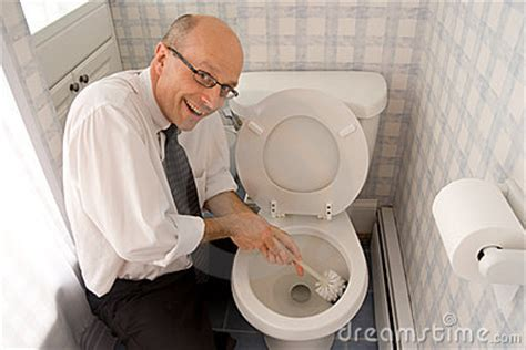 business man cleaning toilet royalty  stock images