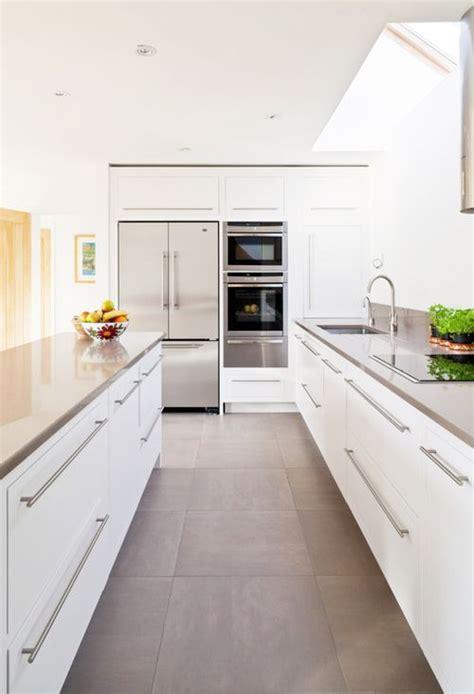 grey large format floor tiles white kitchen white