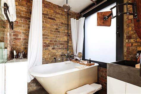 exposed brick walls   bathroom give   rustic