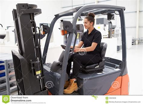 Female Fork Lift Truck Driver Working In Factory Stock