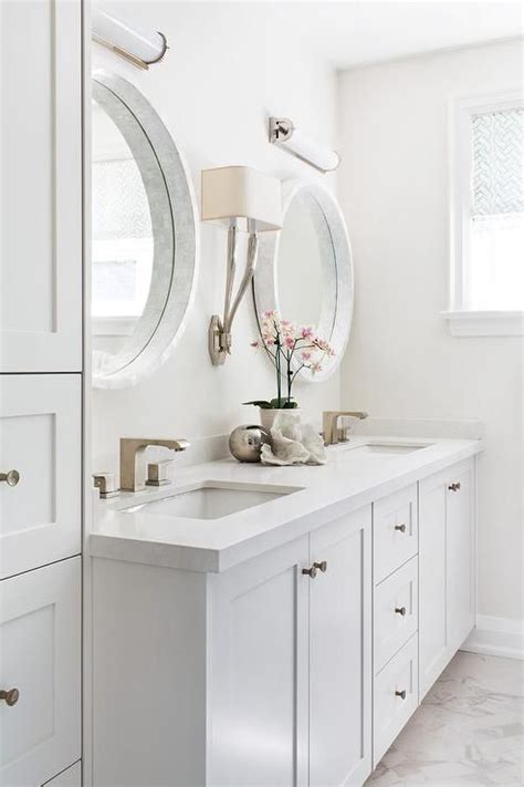 beautiful light gray bathroom is fitted with white glass