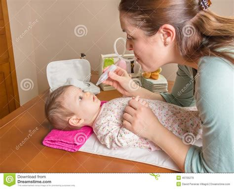 Mother Cleaning Mucus Catarrh Of Son Stock Photo