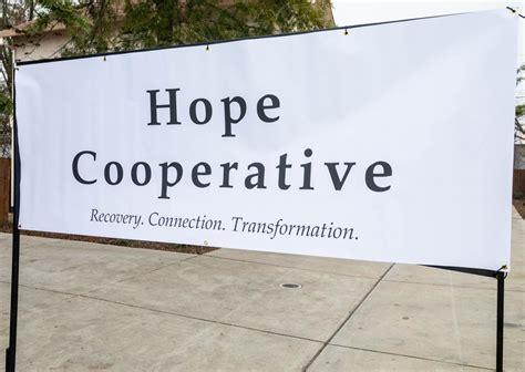 hope cooperative ribbon cutting comstocks magazine