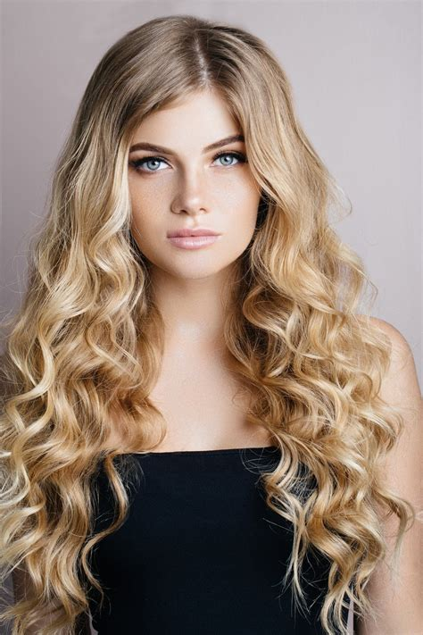 loose curly hairstyles 24 loose perm styles that will have you craving curls