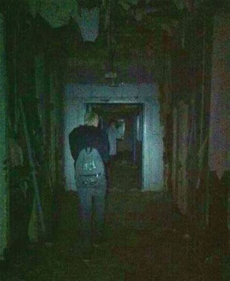 PICTURED: Moment 'creepy ghost' photo-bombs family's next