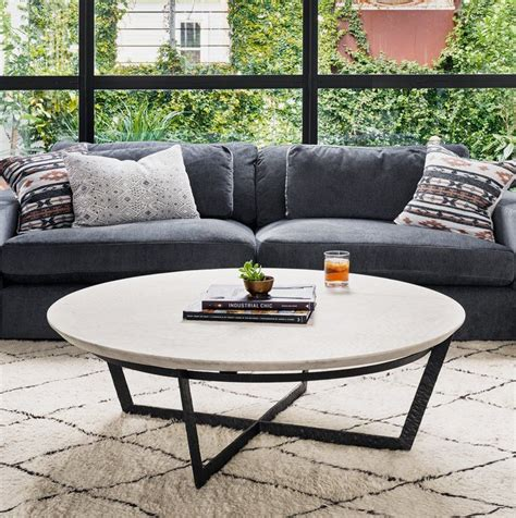 If you have a modern living space, then this is your perfect rounded coffee table. Living room idea with small round marble coffee table | Coffee table, Marble coffee table, Round ...