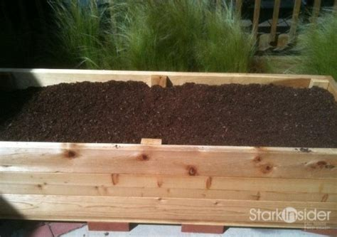 how to make a wooden planter box build a vegetable planter box with these plans stark insider