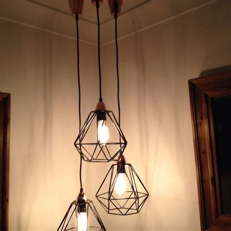 Love this grouping of these kmart geo pendant lights using