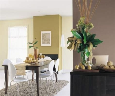 green and brown feature walls with a neutral colour to