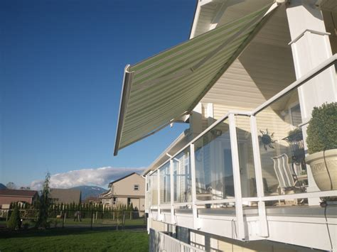 green striped motorized awning ft wide clear span