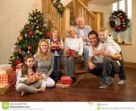 family at home around christmas tree stock photo image 20461502
