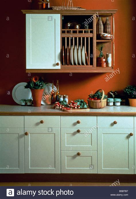 plate rack  wooden shelves  wall unit  red kitchen  white stock photo  alamy