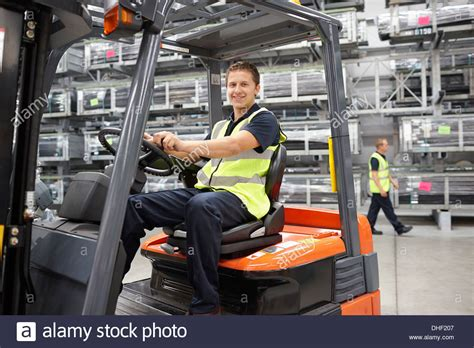 Forklift Truck Driver In Engineering Warehouse Stock Photo