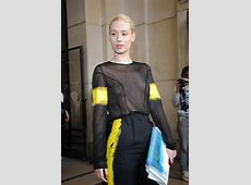 Iggy Azalea shows off her tits wearing a see through top