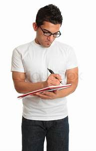 Man writing in a book notepad | Stock Photo | Colourbox