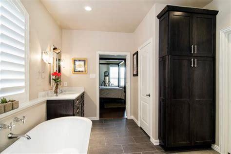 modern neutral master bathroom  large linen closet hgtv