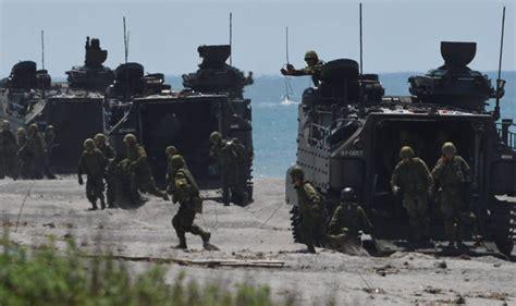 japan    huge show  military  troops storm