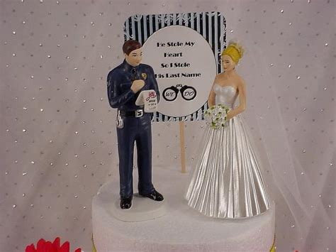 Elegant Bride With Bridal Veil And Policeman Wedding Cake