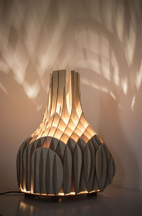 soft glow cast by original plywood lighting unit from mariam ayvazyan freshome