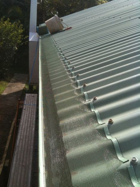 decorating with leaf guards leaf free gutter guard on metal roof budget patio metal roof facade house budget patio