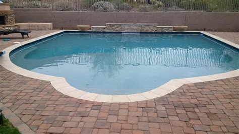 perimeter pool  sheer decent  paver  travertine