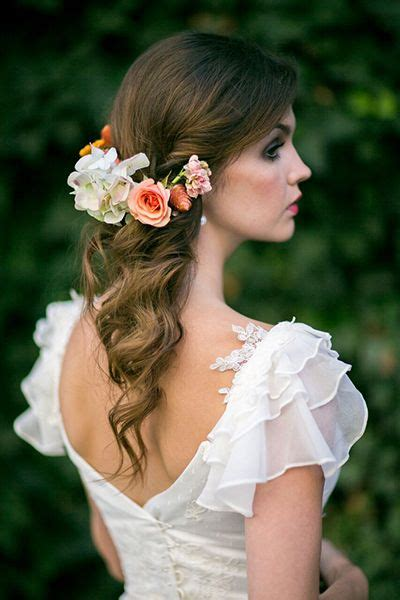 Flower Hairpiece Pulled Back Wedding Hairstyle MODwedding
