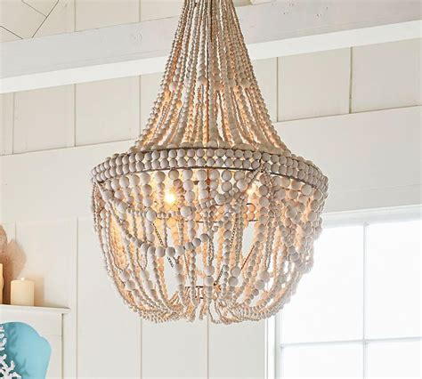 metal chandelier with white washed wood
