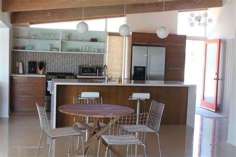 mid century modern kitchen warm wood lights door beams
