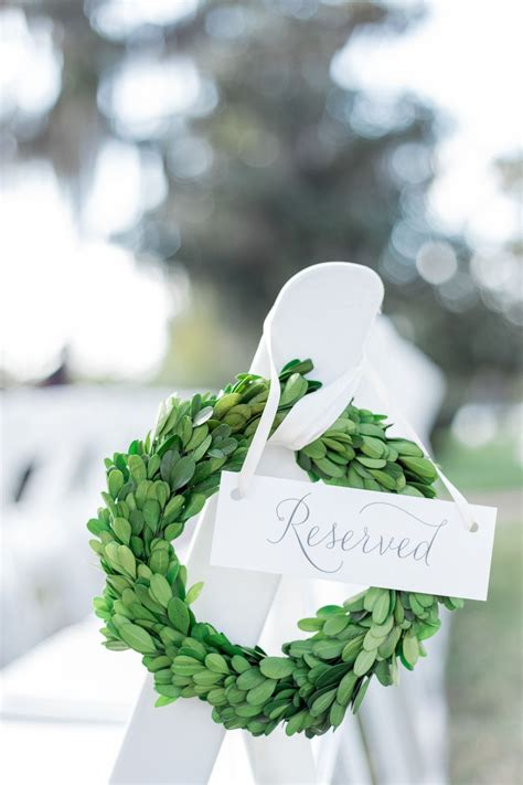 Outdoor Wedding Pew Marker Is A Petite Boxwood Wreath