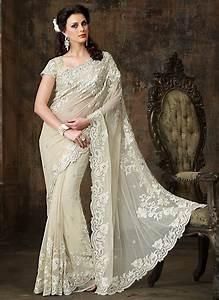 Exotic Off White Net Wedding Saree