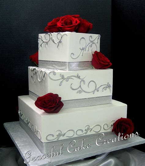 elegant square white butter cream wedding cake decorated