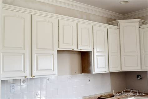 painting kitchen cabinets white beneath  heart