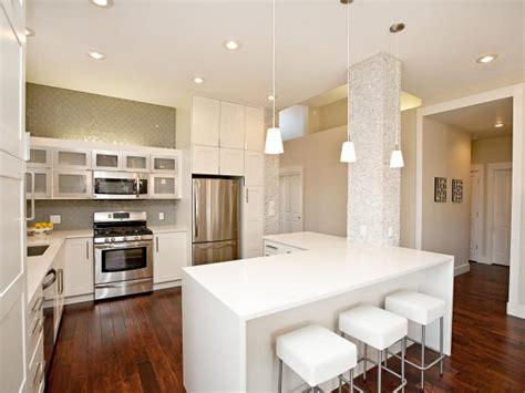 white kitchen  wood floors   shaped island hgtv