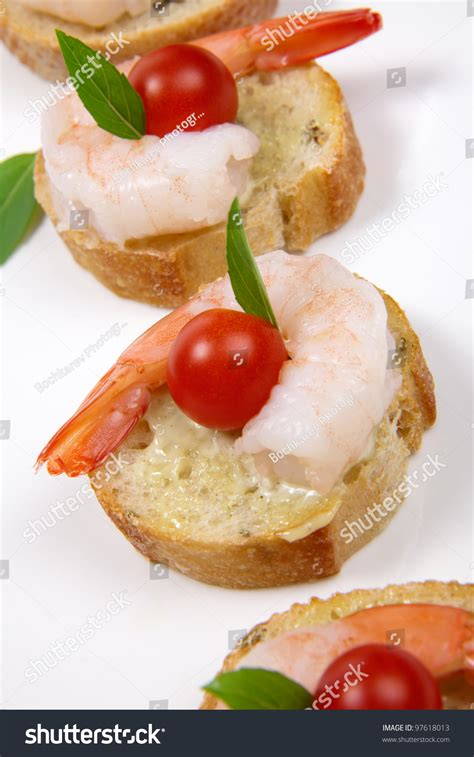 canape spread closeup of delicious shrimp canape with cherry tomatoes