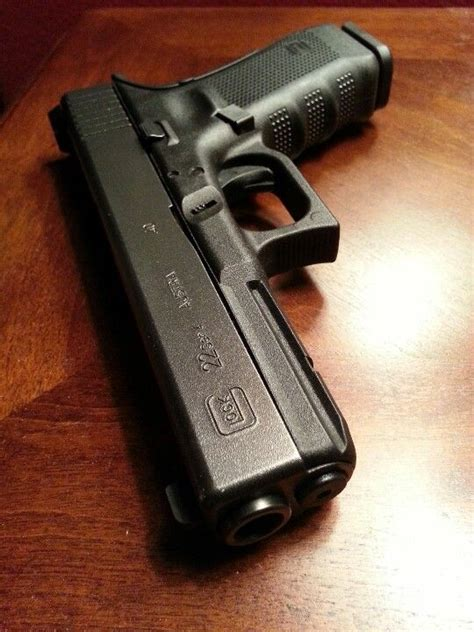 glock 22 4 just like mine exactly what i plan on buying glock and a 40 cal couldn t ask