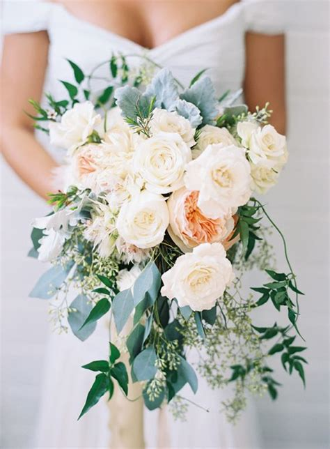 prettiest fall wedding bouquets  stand