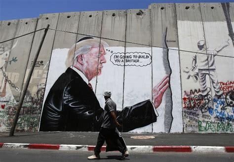 trump invokes israels wall  tense exchange