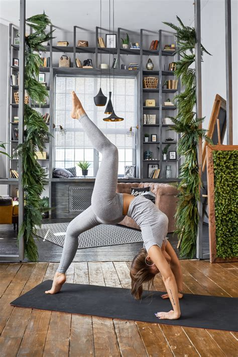 Woman Practicing Yoga In The Living Room Stock Photo 17. Average Cost Of Basement Finishing. Insta Dry Basement Systems. Basement Playroom Ideas. Mice In The Basement. Basement Review. Musty Basement Smell Causes. Kitchen In Basement Design. Basement Restaurant Padstow