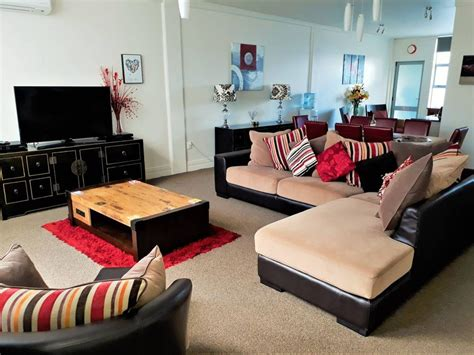 Living Room With Tv As Focus by City Focus Apartment On Hinemoa No Cleaning Fee