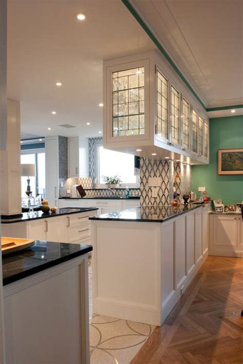 black white open plan kitchen  glass front cabinets