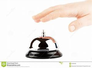 Ringing A Bell For Service With Hand Stock Photo