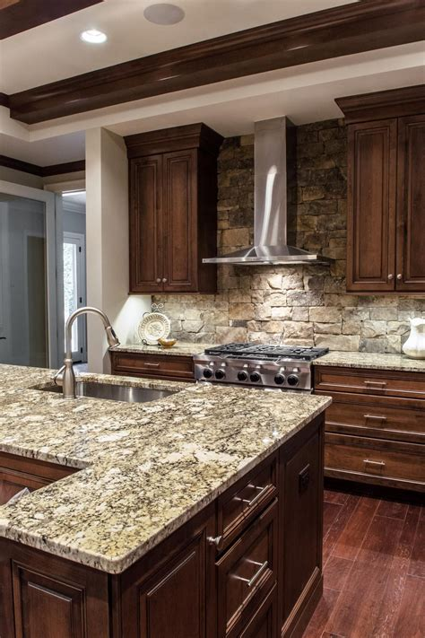 custom wood cabinets  gray stone countertops  top