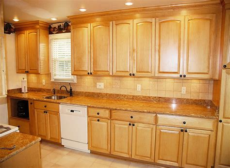 golden oak cabinets with white appliances maple arched