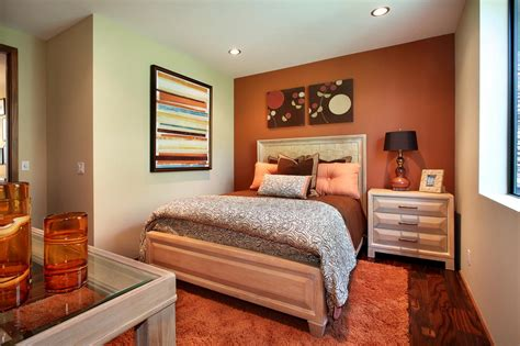 orange accent wall energizes transitional bedroom hgtv