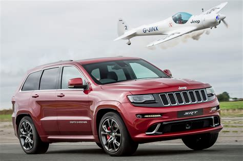 srt8 jeep jeep grand cherokee srt8 vs plane pictures auto express