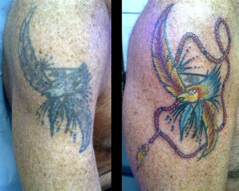 tattoo tatouage recouvrement bras aigle plume tatouages