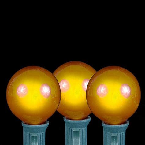 yellow g40 globe outdoor string light set on white
