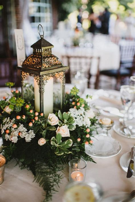 Lantern And Greens Centerpiece Centerpieces In 2019