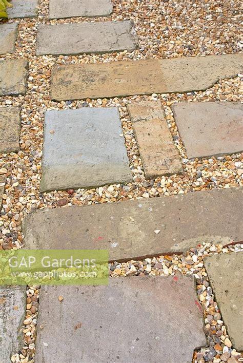 gap gardens stone paving slabs  gravel path image