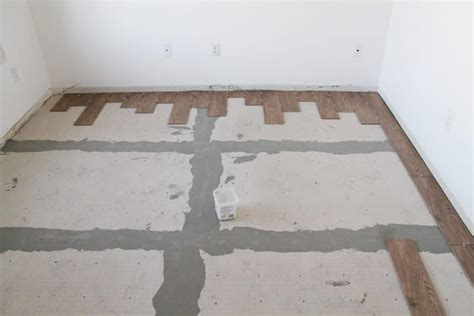 laying tile on wood floor tips for achieving realistic faux wood tile chris loves